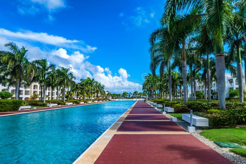 Luxury tropical hotel in Dominican Republic. Pool in the resort and spa luxury tropical hotel in Punta Cana, Dominican Republic stock photography