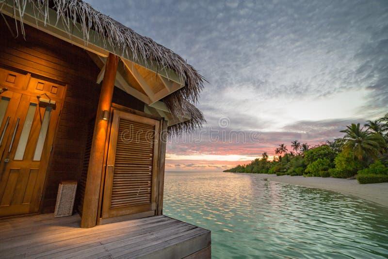 Sunset on Maldives island, water villas resort royalty free stock photo