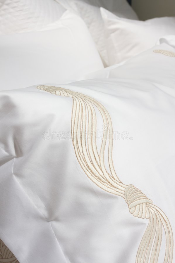 Luxury upscale bedding and linens. An image of luxurious upscale bedding and linens stock photography