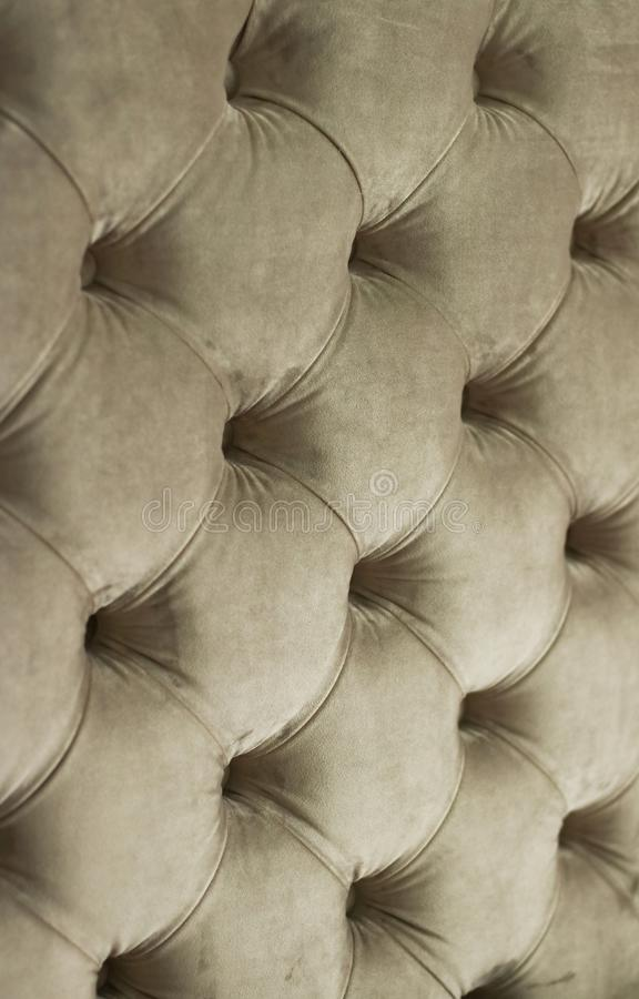 Luxury velour quilted sofa upholstery with buttons, elegant home decor texture and background. Furniture design, classic interior and royal vintage material royalty free stock photography