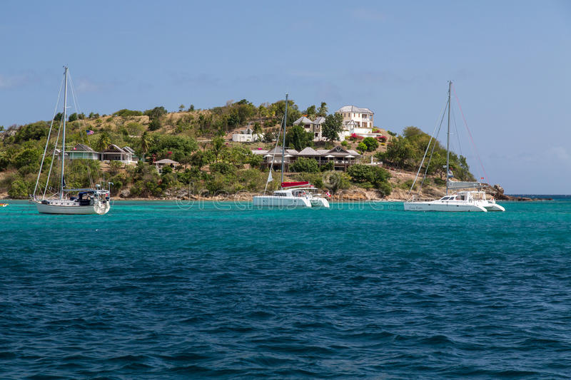 Luxury villas and boats near Pigeon Beach stock images