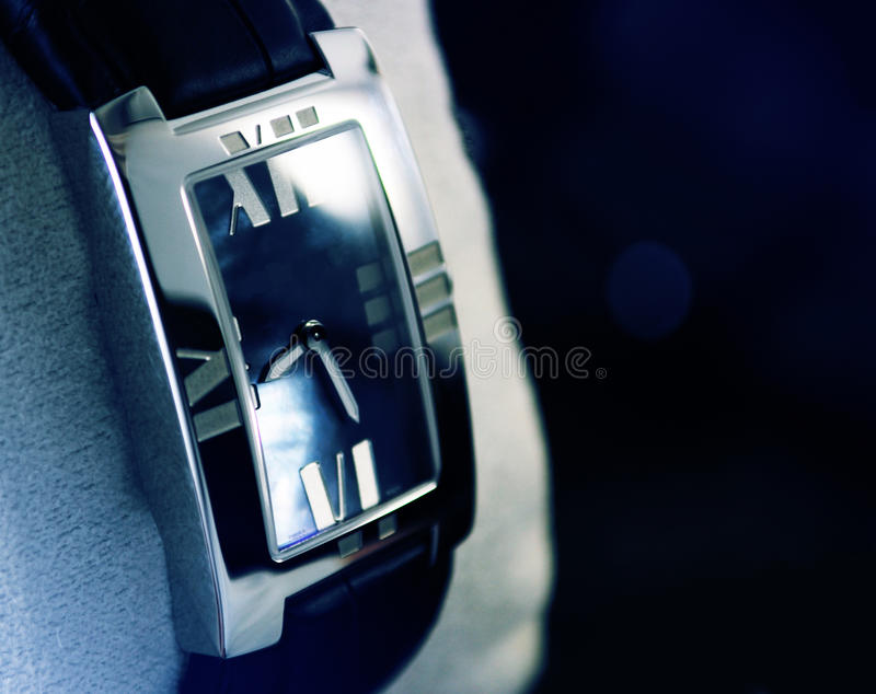 Luxury watch. This photograph represent a luxury, swiss made platinum watch in store. Extreme close-up, great dof stock images
