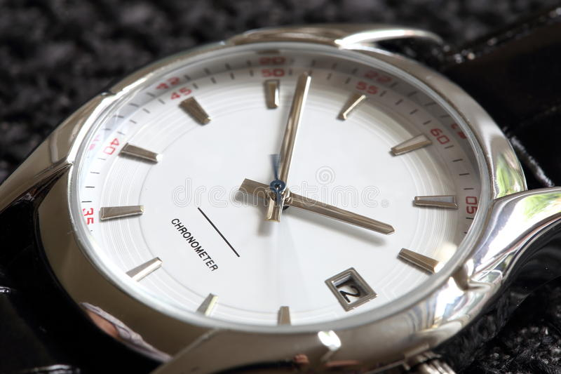 Luxury watch. Closeup of luxury men's watch with motion blur effect on the seconds-dial royalty free stock photography