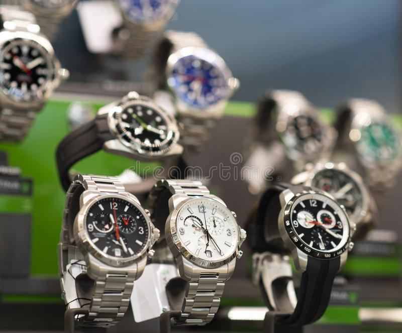 Luxury men`s watches in a store. Luxury watches in a store stock photos