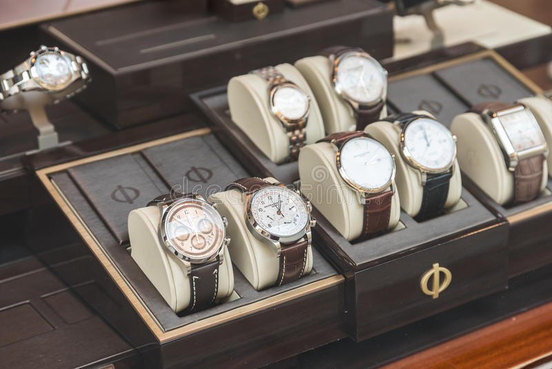 Luxury Watches For Sale In Shop Window Display. BUCHAREST, ROMANIA - MAY 24, 2015: Luxury Watches For Sale In Shop Window Display royalty free stock images