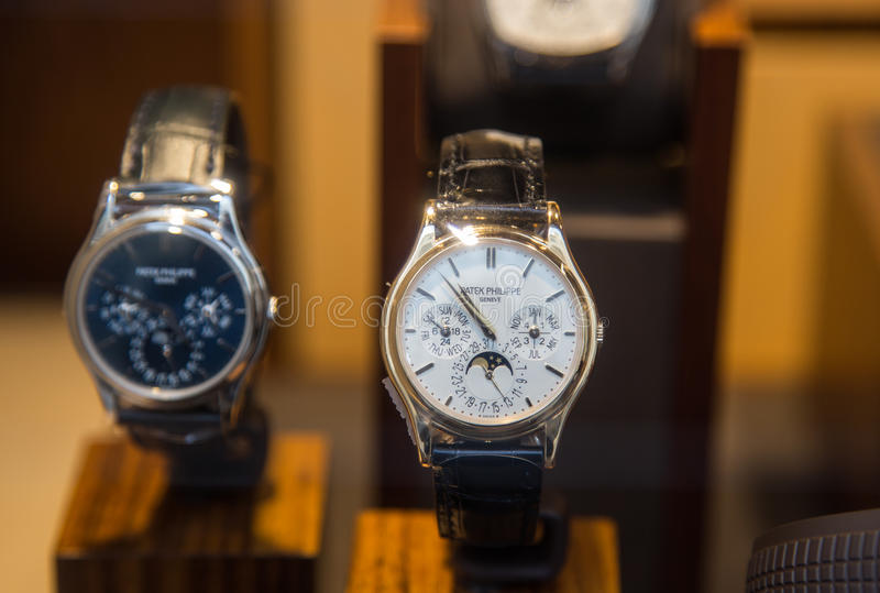 Luxury watches shop. Swiss made Patek Philippe expensive watch is displayed for sale in luxury shop stock photography