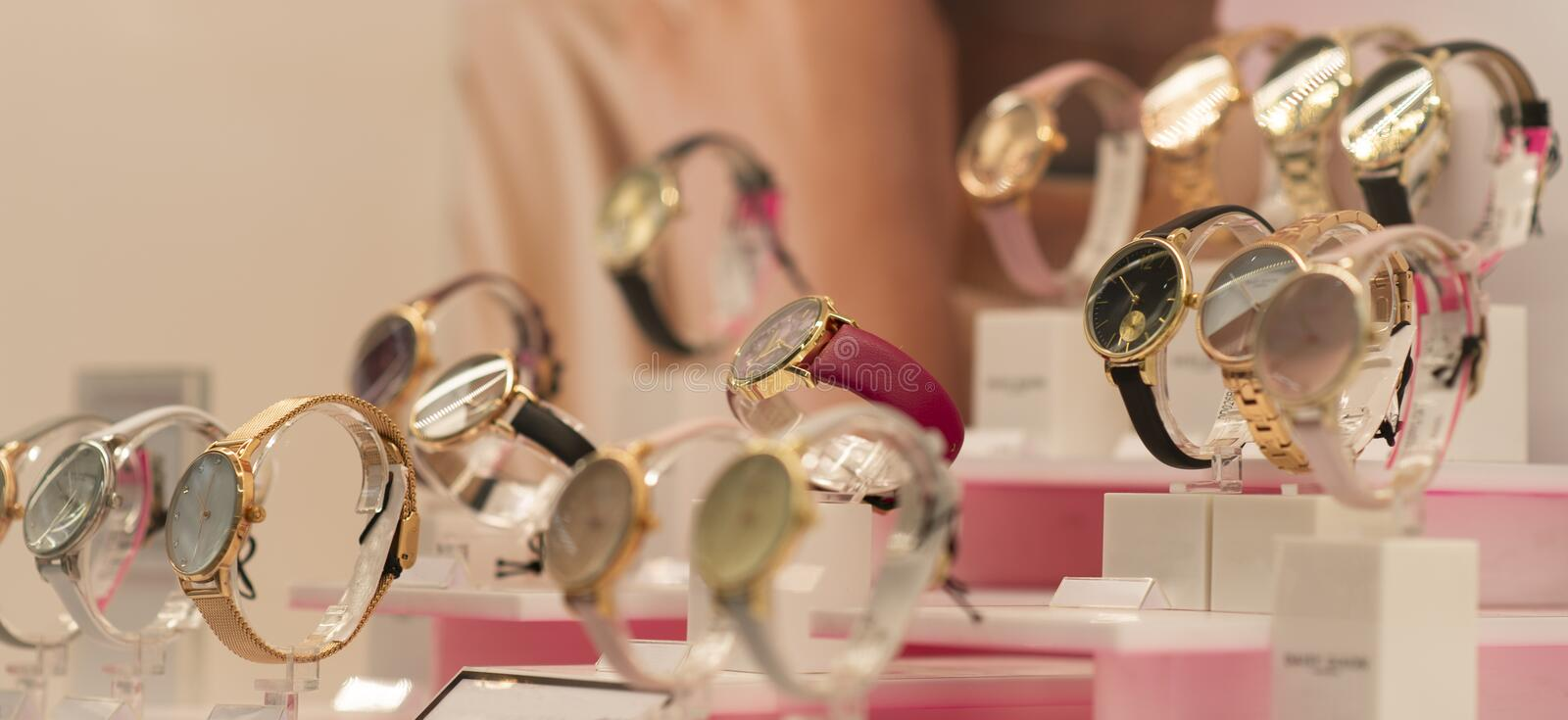 Luxury women`s watches in the shop. Luxury watches in the shop stock photography