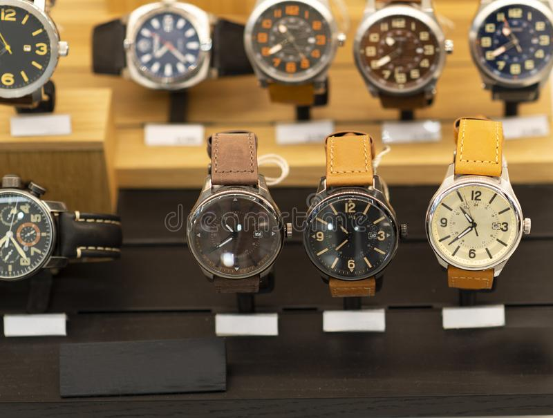Luxury men`s watches at the store. Luxury watches in a store stock image