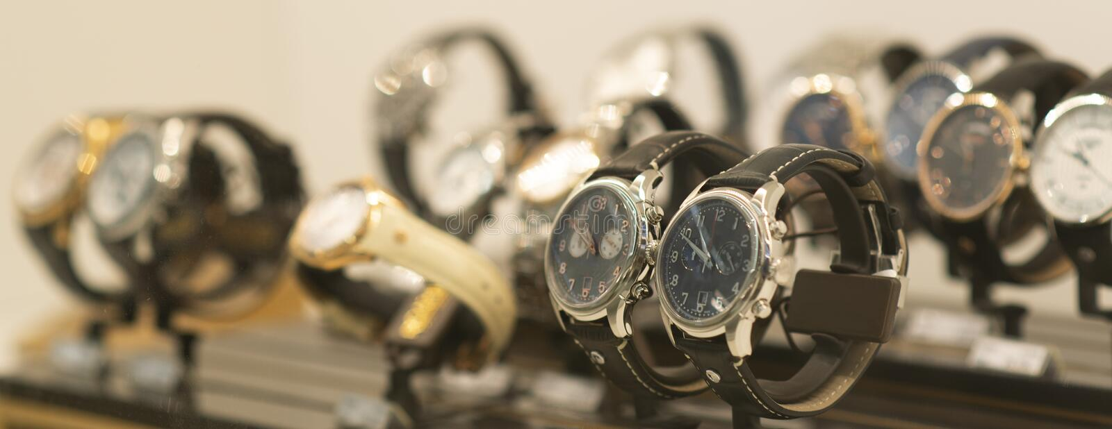 Luxury men`s watches at the store. Luxury watches in a store royalty free stock photography