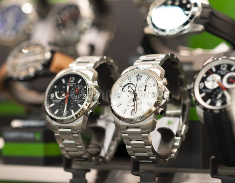 Luxury men`s watches in a store. Luxury watches in a store stock photography