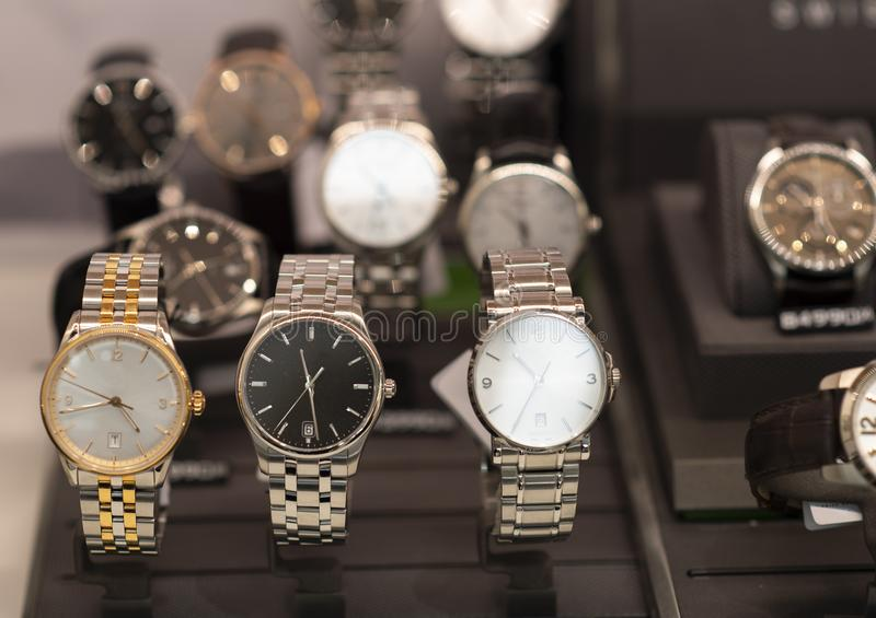 Luxury men`s watches in a store. Luxury watches in a store stock photo