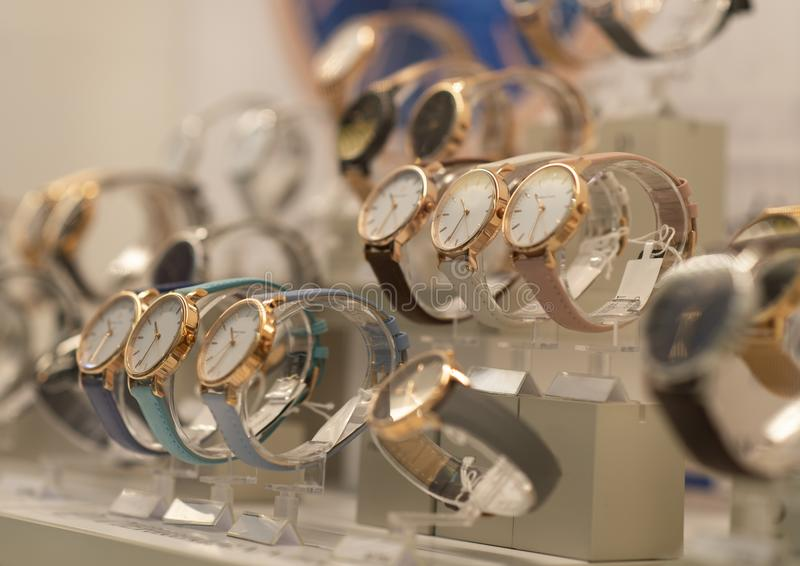 Luxury men`s watches in a store. Luxury watches in a store stock image