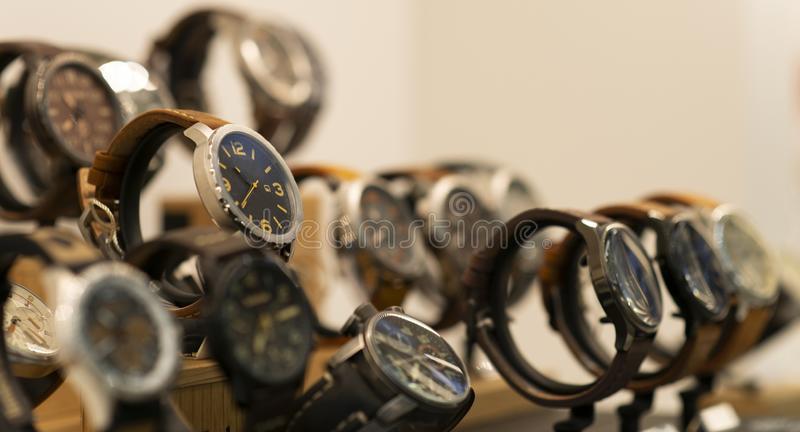 Luxury men`s watches at the store. Luxury watches in a store stock photos
