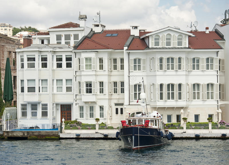 Luxury water front villa with boat royalty free stock photos