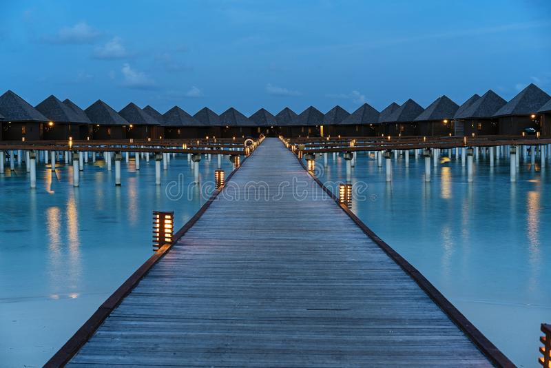 Luxury water villas sunset in Maldives stock images
