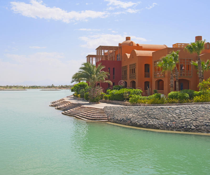 Luxury waterfront residence. Large luxury waterfront residence in a tropical resort stock photos