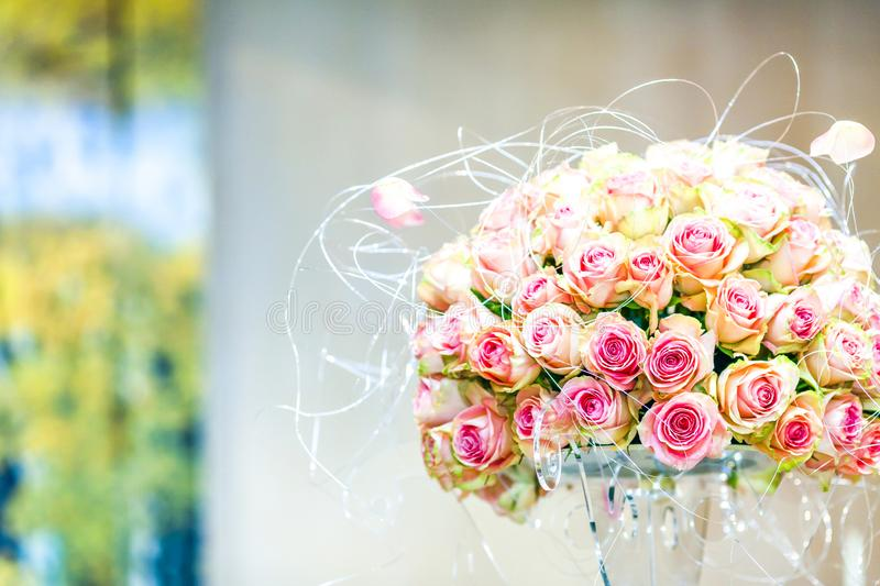 Luxury wedding bouquet of pink roses and silver lining stock photo