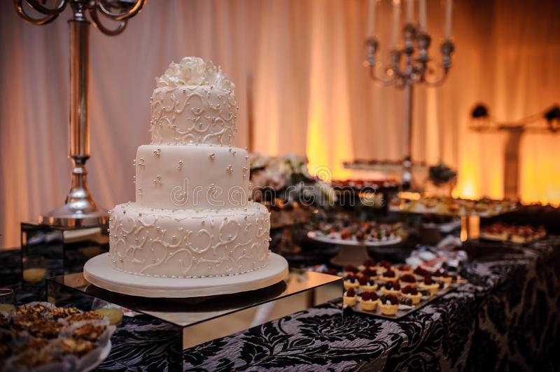 Luxury wedding candy bar with cake, pastries, macaroons and cake pops stock images
