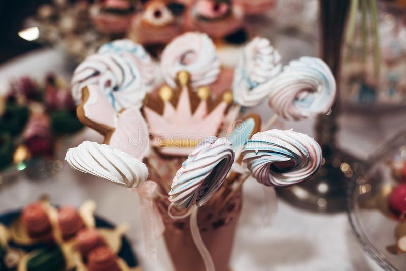 luxury wedding catering, table with modern pops desserts, cupcakes, sweets with fruits. delicious candy bar at expensive wedding royalty free stock photography