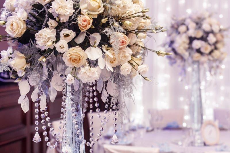 Luxury wedding decor with flowers of roses and hydrangea closeup stock photos