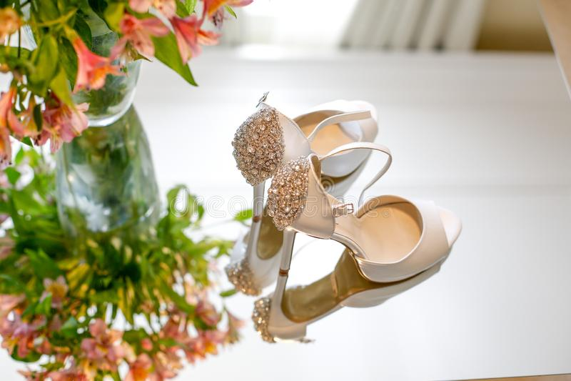 Luxury wedding shoes for bride. Near flowers royalty free stock images
