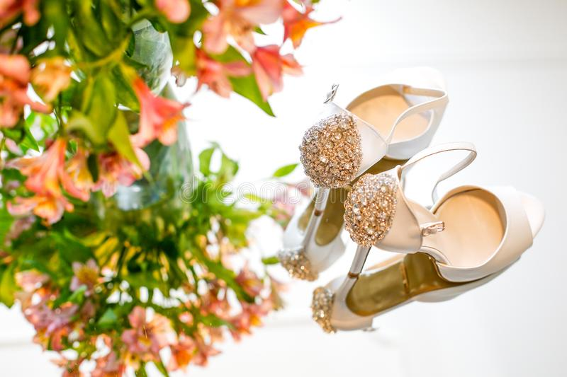Luxury wedding shoes for bride royalty free stock photography