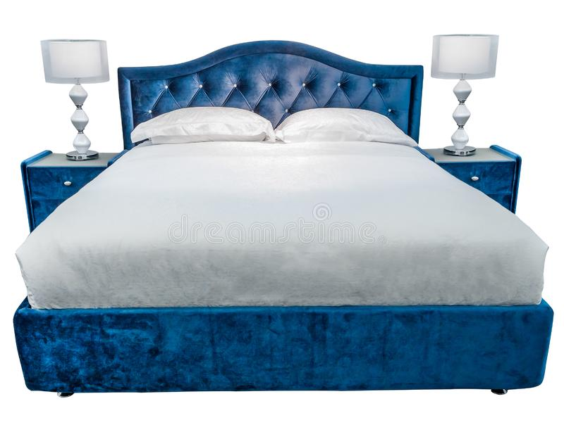Luxury white blue modern bed furniture with two night lamps on the bedside tables, with patterned cover, with velour stock photography