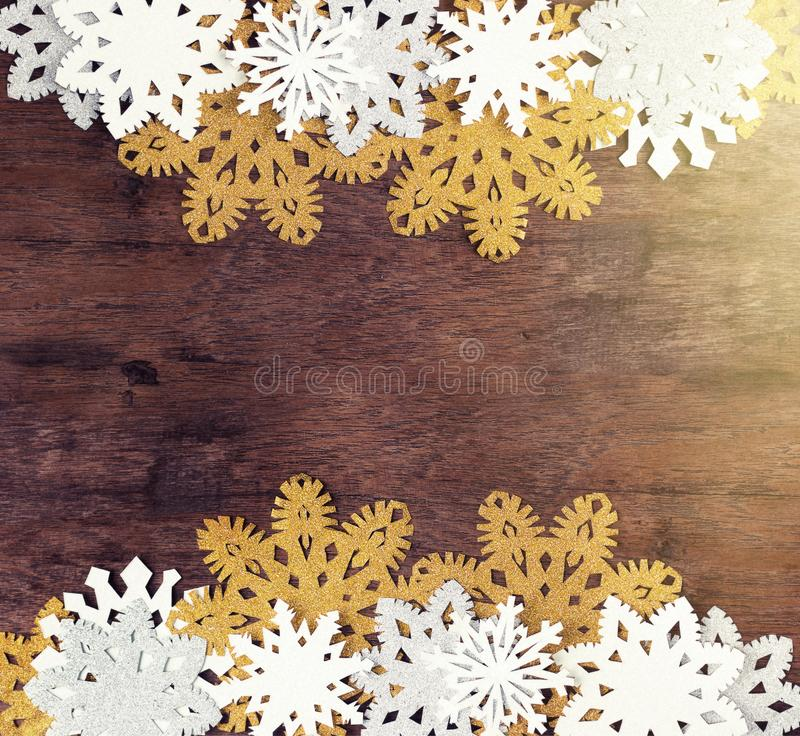 Luxury white and golden snowflakes on dark wooden background. Winter, Christmas, New year concept. Rustic royalty free stock photos