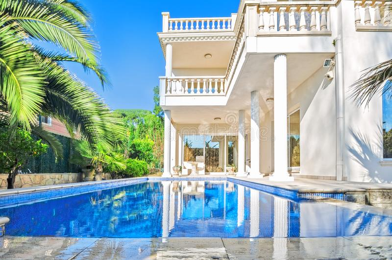 Luxury white house with swimming pool. Luxury villa in classica stock images