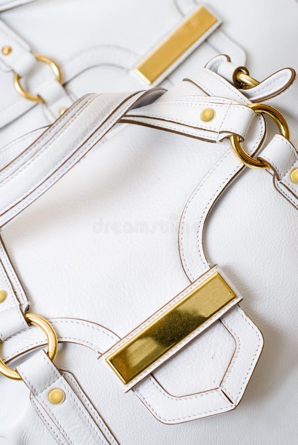 Luxury white leather female bag. Macro of luxury white leather female bag royalty free stock images