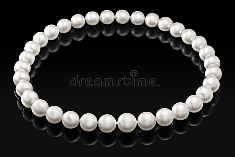 Luxury white pearl necklace on a black background with glossy reflection.  royalty free stock photos