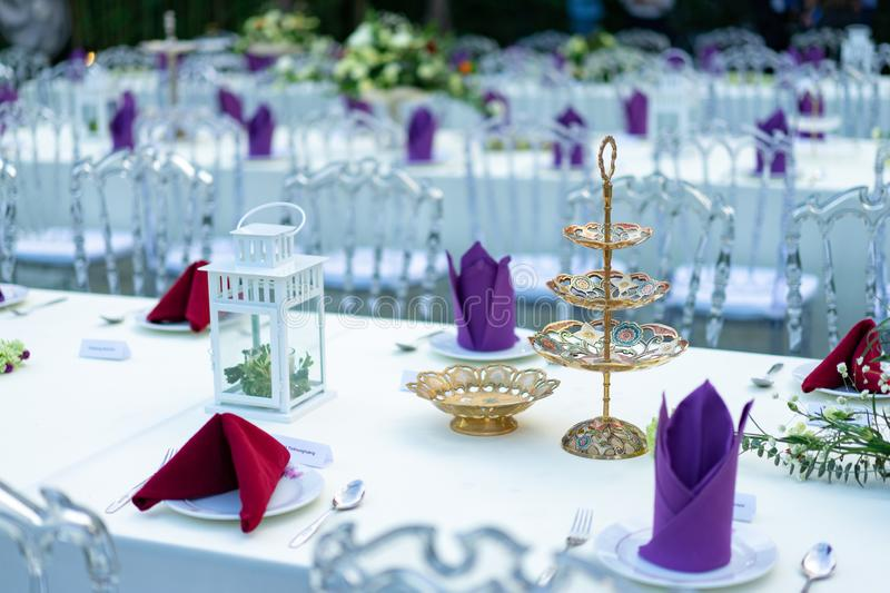 Luxury White - Purple - Red Dinner table set with Crystal chair in the garden stock image
