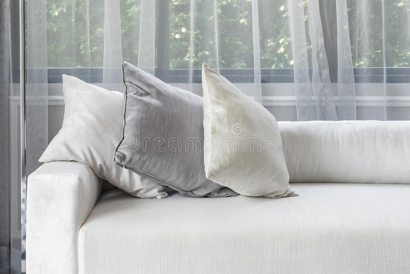 Luxury white sofa with pillows set in living room. Design royalty free stock photography