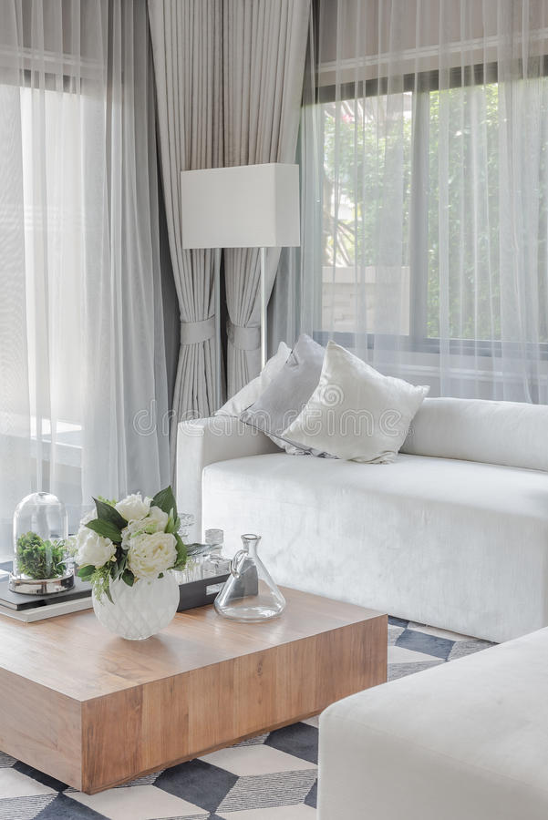 Luxury white sofa with pillows set in living room. Design stock photos