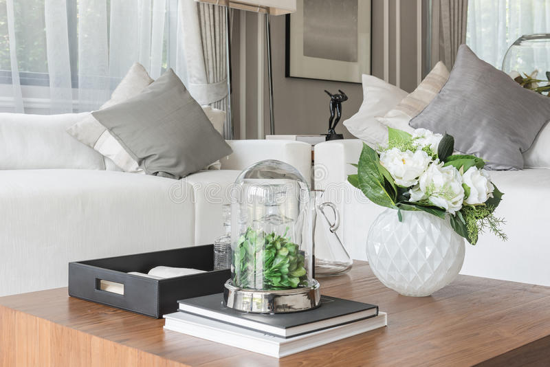 Luxury white sofa with pillows set in living room. With vase of flower on wooden table stock images