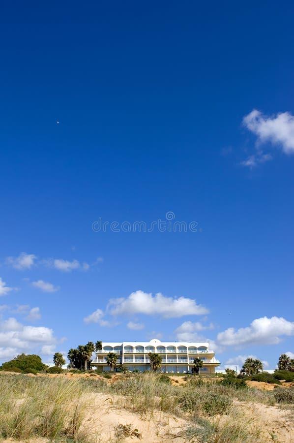 Luxury white Spanish hotel on the beach