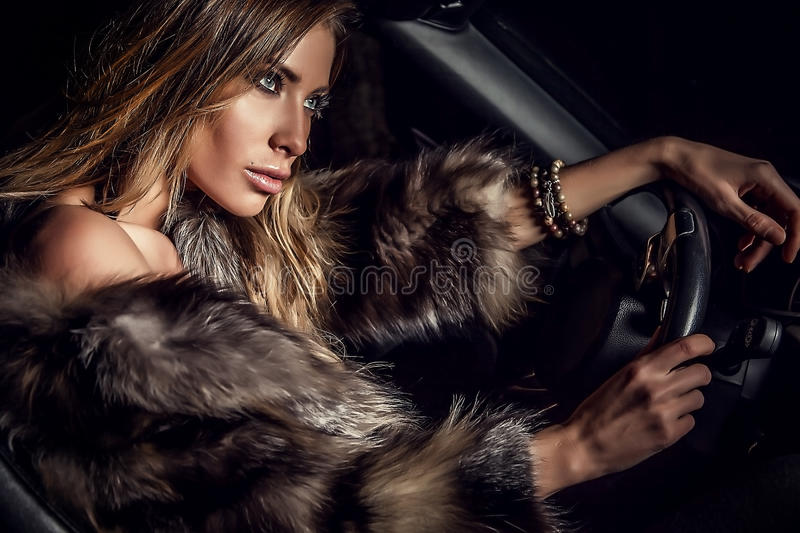 Luxury woman in a car. Photo stock photo