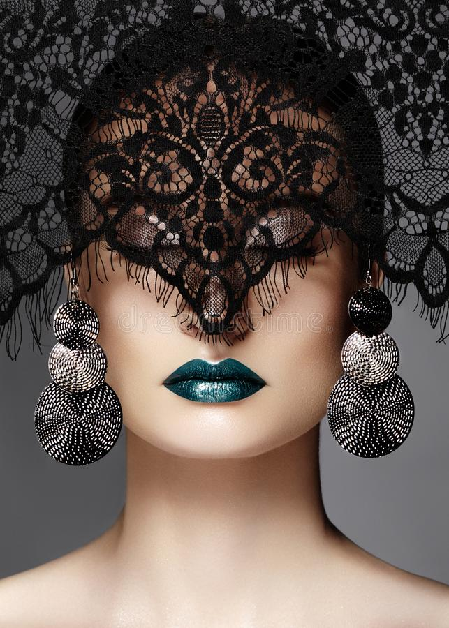 Luxury Woman with Celebrate Fashion Makeup, silver Earrings, black Lace veil. Halloween or Christmas style. Lips Make-up stock photography