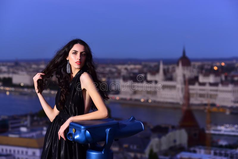 Luxury woman in evening dress with view on city. girl in elegant dress. Modern life with princess in celebrity stock photo