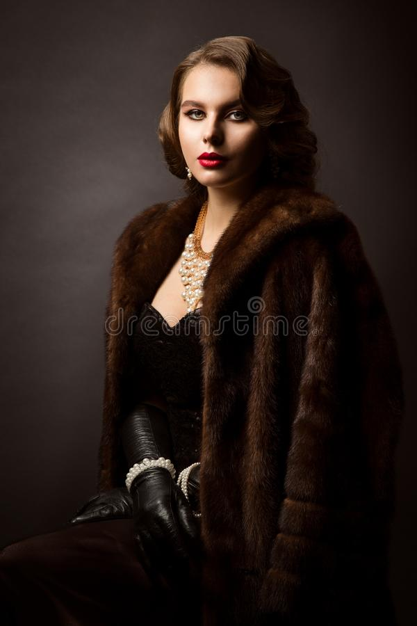Luxury Woman in Fur Coat, Fashion Model Beauty Portrait, Old Fashioned Well Dressed Lady royalty free stock photography