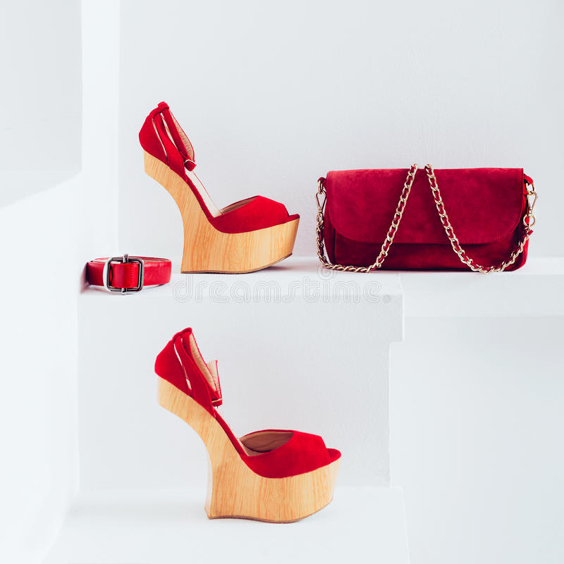 Luxury women's accessories. Bag and strap. Stylish shoes. Red accent in clothes royalty free stock photo