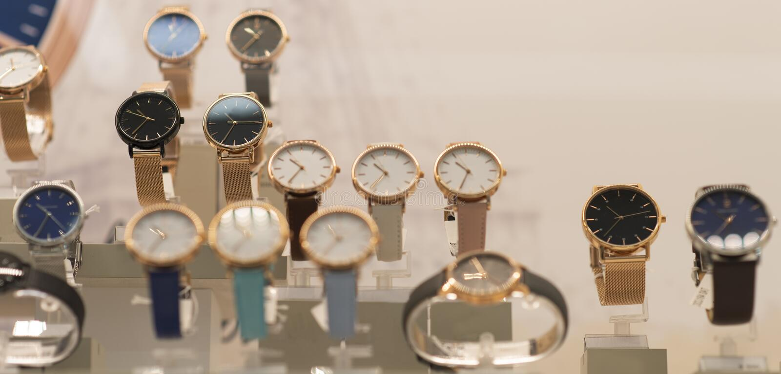 Luxury women`s and men`s watches in the store. Luxury watches in a store stock photos
