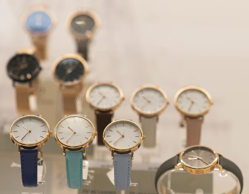 Luxury women`s watches in the shop. Luxury watches in a store royalty free stock photo