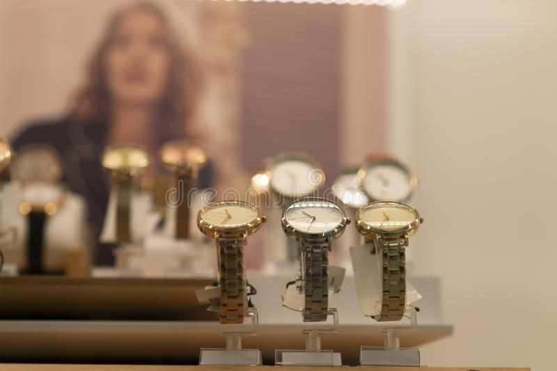 Luxury women`s watches in the store. Luxury watches in a store stock image