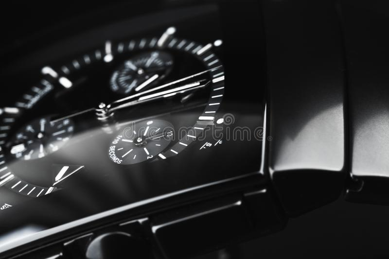 Luxury wrist watch made of black ceramics. Luxury wrist watch made of black high-tech ceramics. Close-up studio photo with selective focus royalty free stock images