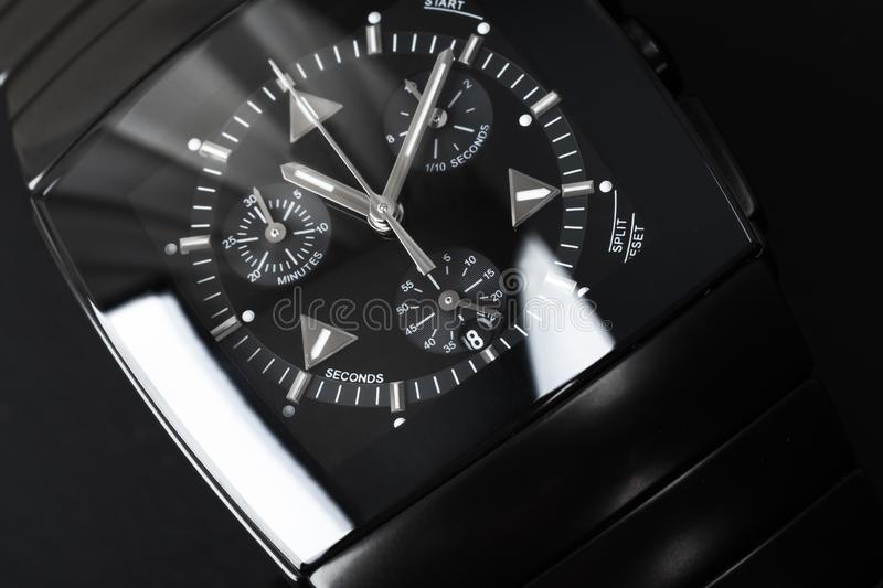 Luxury wrist watch made of high-tech ceramics. Luxury wrist watch made of black high-tech ceramics. Close-up studio photo with selective focus royalty free stock photo