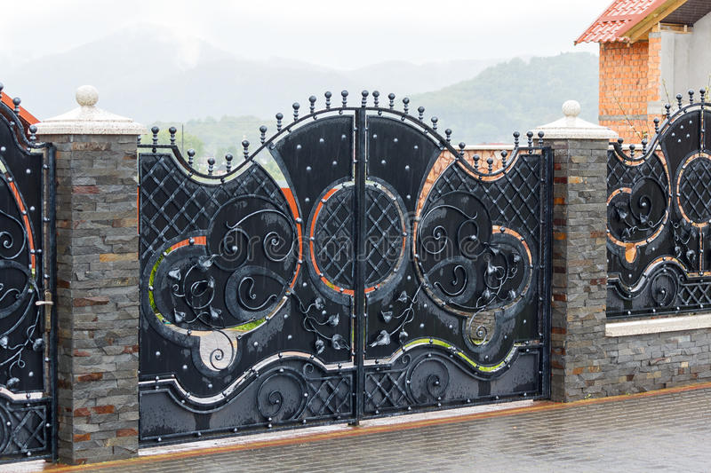 Luxury wrought iron gates royalty free stock photography
