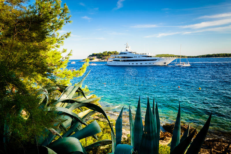 Download Luxury Yacht Anchored In A Beautiful Bay Surrounded By Greenery Stock Image - Image: 36469133