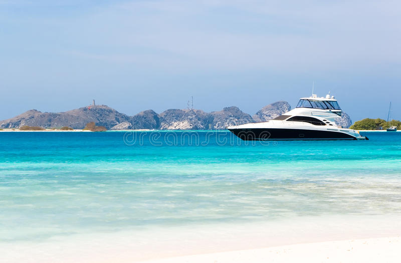 Luxury yacht by the beach stock photo