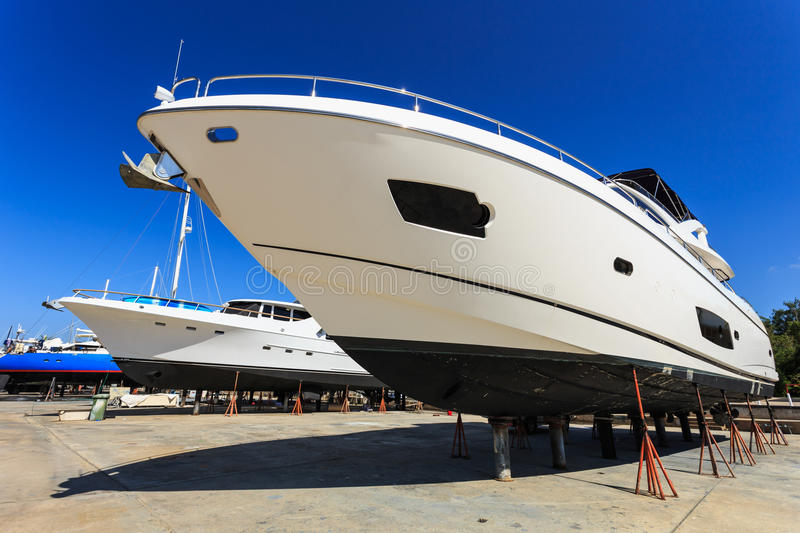Luxury yacht beached for annual service and repair. Luxury yacht beached for annual service stock photo